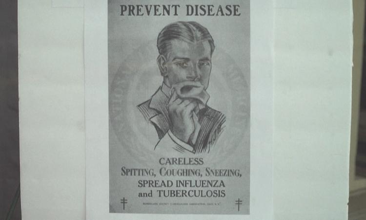 letreros que promovían la prevención de la gripe española en EU